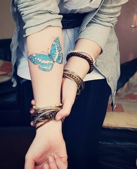 Butterfly wrist tattoo